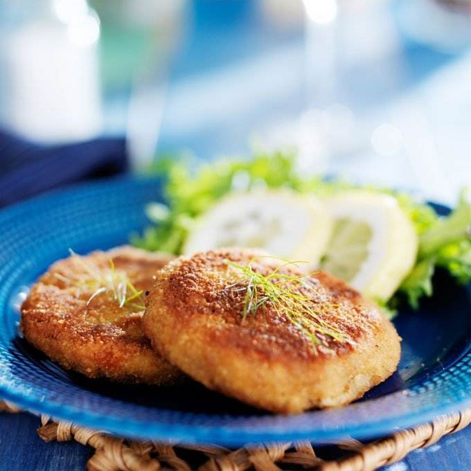 Crab cakes on blue plate