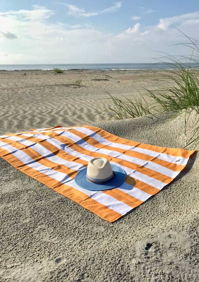 Beach towel and sunhat | Essential Beach Gear for a Day at the Beach