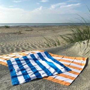 beach towels on sand dune at beach