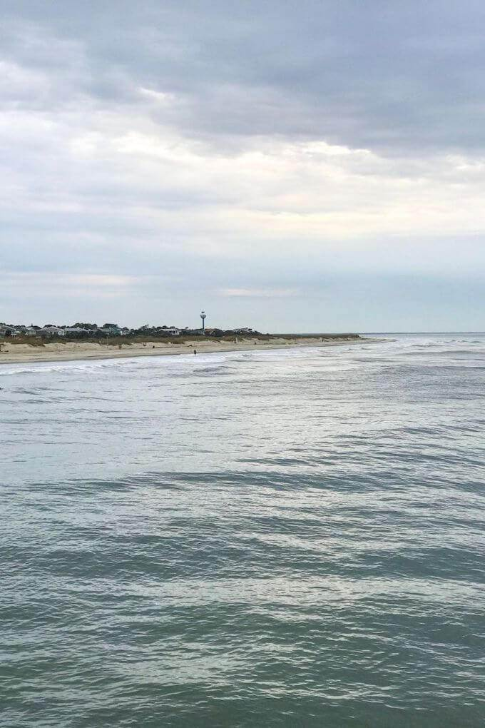A view of the Tybee Island shoreline with the Tybee Lighthouse in the distance