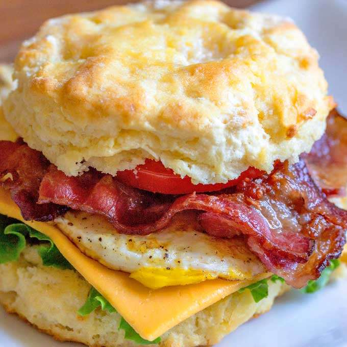 Biscuit breakfast sandwich with bacon, egg and cheese