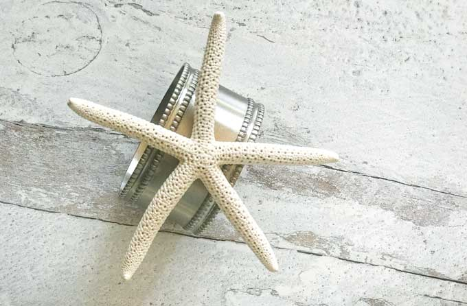 Starfish napkin ring on weathered wood