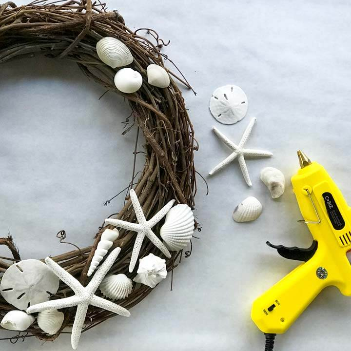 Sea shells, grape vine wreath and hot glue gun