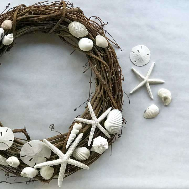 Seashell wreath with starfish, sand dollars, clam and spiral shells