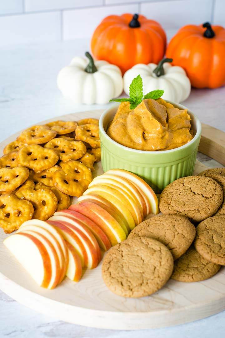 Pumpkin cheesecake dip with ginger snaps, apples, pretzels