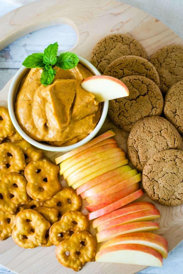Pumpkin pie dip with apple slices, ginger snaps, pretzels