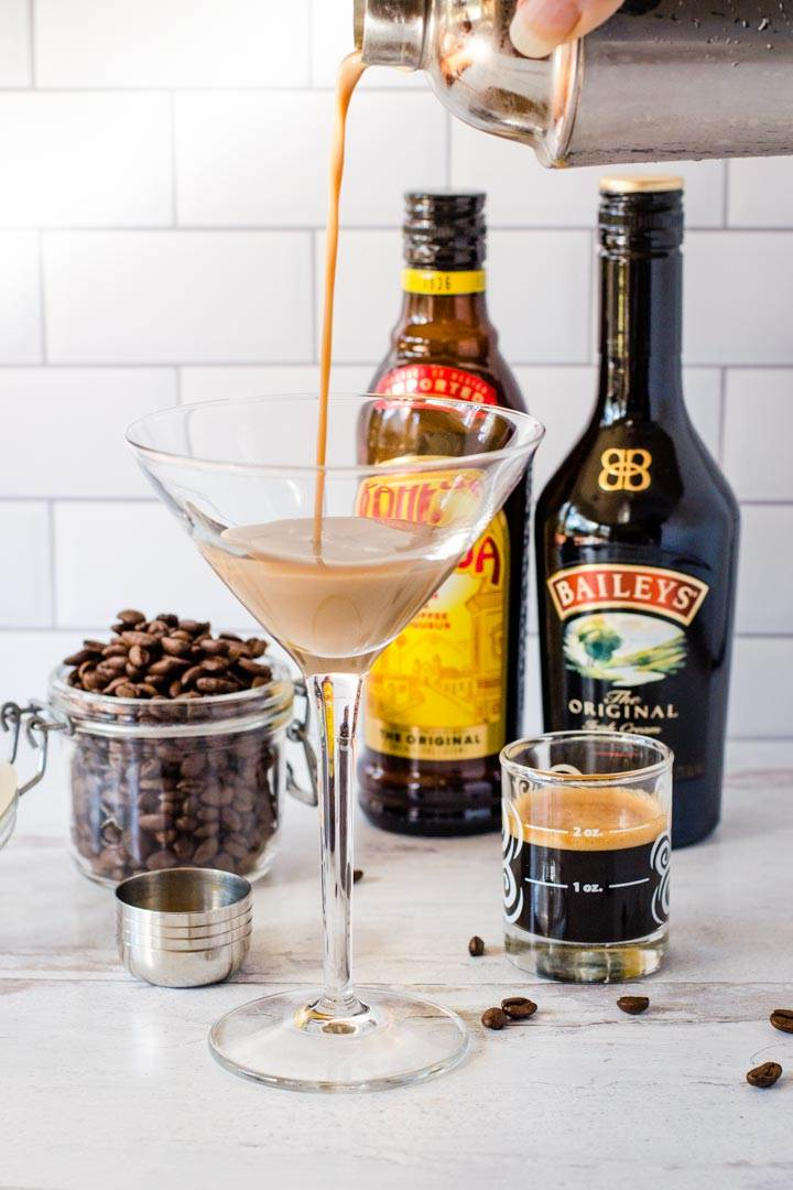 Coffee cocktail pouring into glass