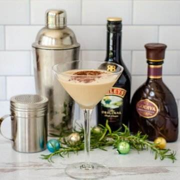 Godiva chocolate martini with Baileys, cocktails shaker and cacao powder