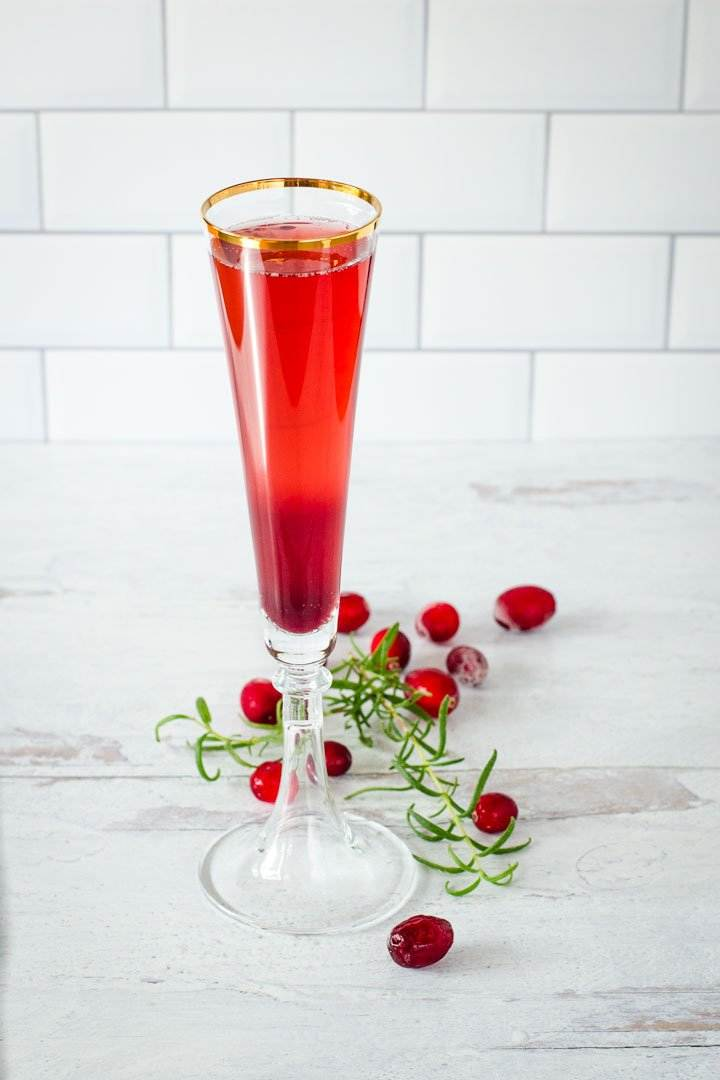 Holiday cocktail with cranberries and rosemary