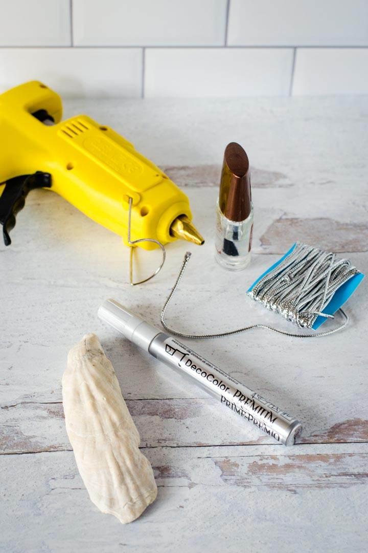 Hot glue gun, nail polish, cord, marker, shell