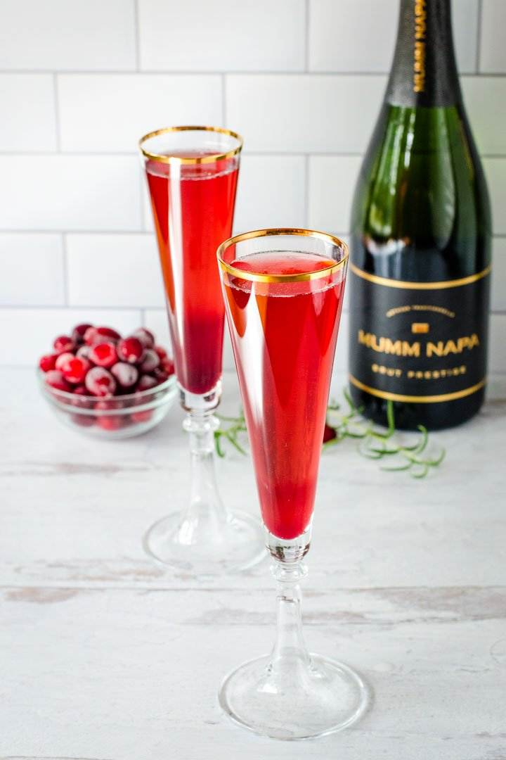 Champagne flutes with pomegranate mimosas
