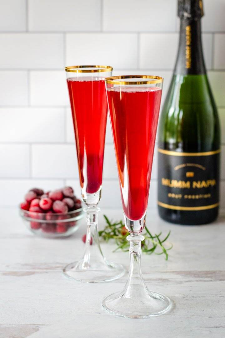 Pomegranate mimosas,champagne, cranberries, rosemary