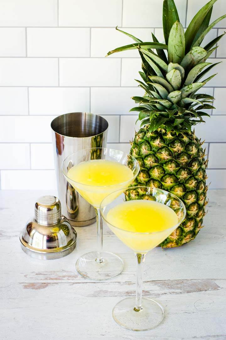 Pineapple drink, cocktail shaker, whole pineapple