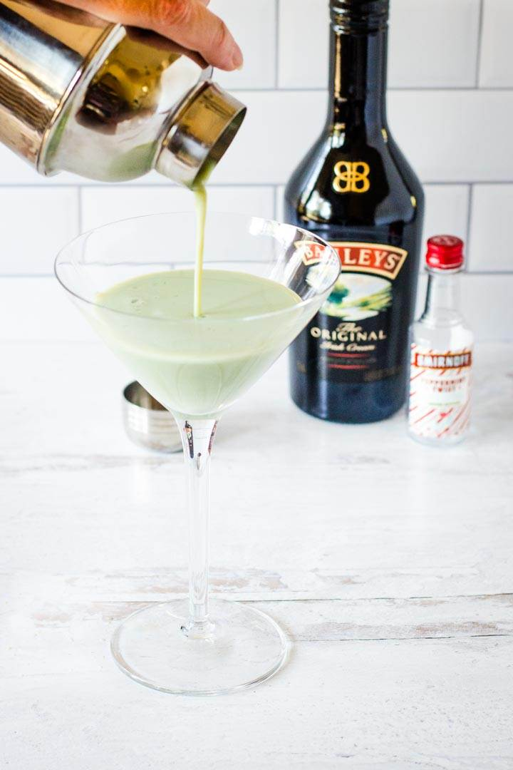 Shamrock cocktail pouring into martini glass