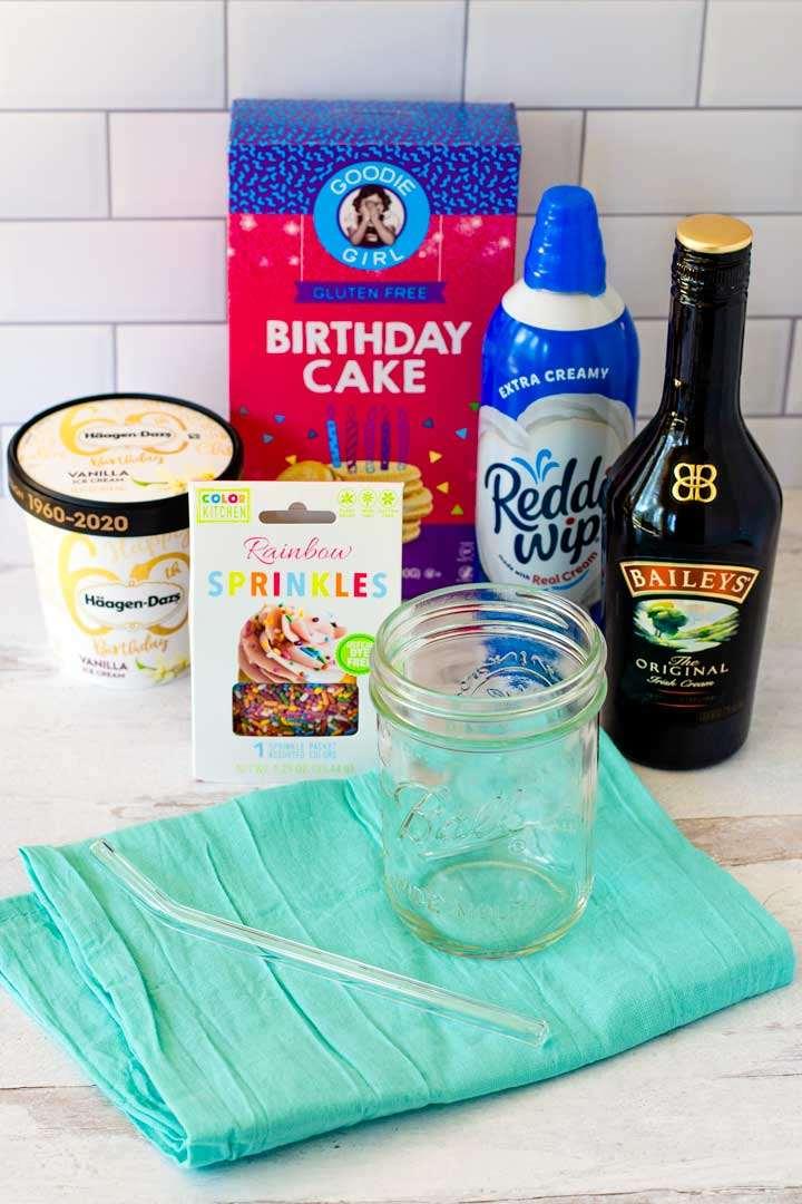 Ice cream, birthday cake cookies, rainbow sprinkles, whipped cream, Baileys, mason jar and glass straw