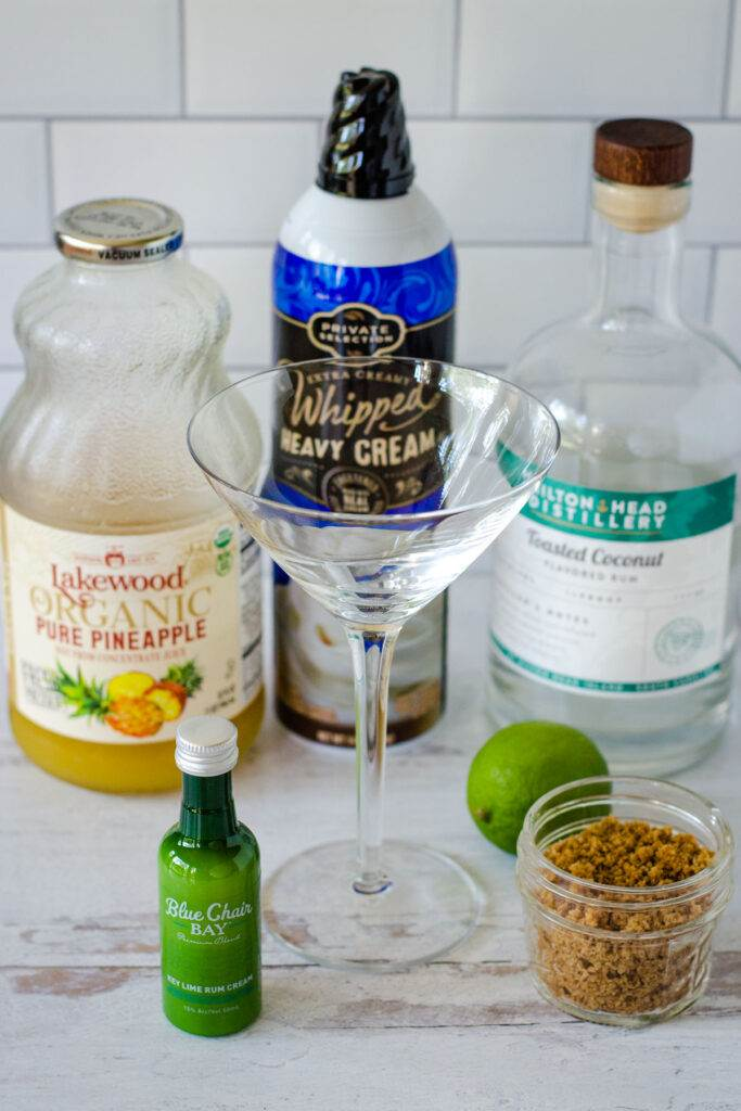Blue Chair Bay Key Lime Rum Cream, pinapple juice, whipped heavy cream, Hilton Head Distillery Toasted Coconut Rum, lime, graham cracker crumbs, martini glass