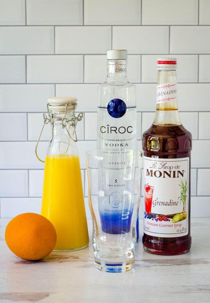 Orange juice, vodka, grenadine, orange and highball glass.